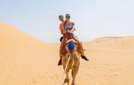 Couple Camel Riding