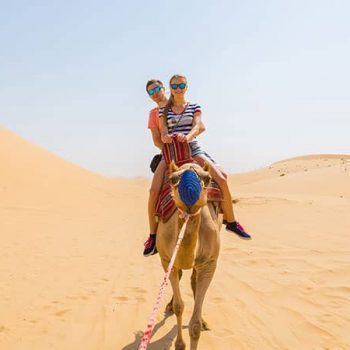 Couple Camel Riding