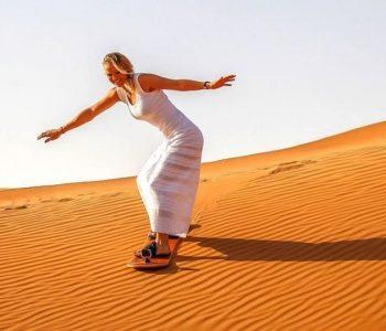 Women Sand Boarding in Desert